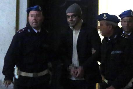Giuseppe Pagliani, consigliere comunale di Forza Italia a Reggio Emilia, arrestato nell'ambito dell'inchiesta 'Aemilia' sulle infiltrazioni della 'Ndrangheta in Emilia-Romagna, lascia il tribunale del riesame di Bologna, 13 febbraio 2015. ANSA/GIORGIO BENVENUTI